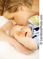 Mother and son - Young attractive mother with cute little...