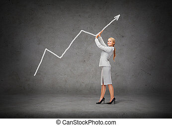 young smiling businesswoman pushing up arrow - business and...