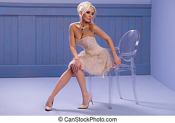 Sexy woman sitting on a chair