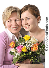 mothers day - mother receives a bunch of flower from her...