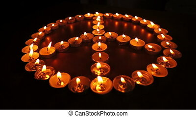 Candles Peace Sign Dolly - Close up curved dolly shot of...