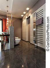 Grey tiled bathroom with silver additions