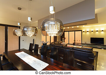 Dining room lighting - A closeup of glass lamps above the...