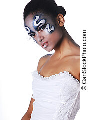 Portrait of beautiful mulatto girl with body art on her face...