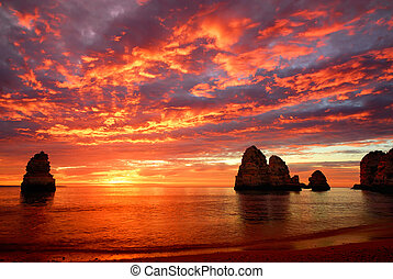 Stunning sunrise over the ocean with beautiful red clouds...