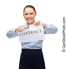 serious businesswoman tearing contract - business,...
