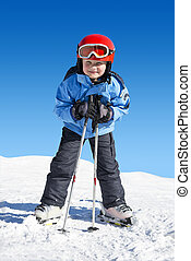 Boy on skis - Young boy on skis, leaning on his poles, ready...