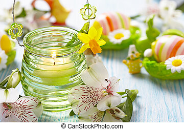 Easter decoration with flowers, candles and eggs