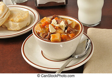 Pot roast soup - A cup of roast beef vegetable soup with...