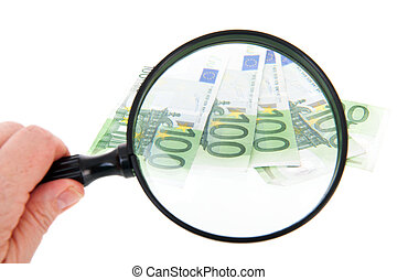 Looking for money - Spy glass with European currency...
