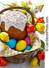 Cake and colorful eggs for Easter