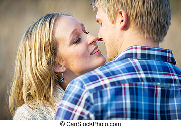 Young couple in love almost kissing - Young Caucasian adult...