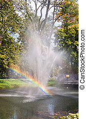 Fountain with rainbow in the park of Czestochowa, Poland