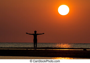 man silhouette - silhouette of single man action at sunset.
