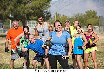 Confident Fit Woman with Group - Smilng woman and boot camp...