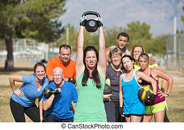 Woman Struggling with Weights