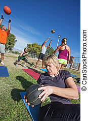 Diverse Group Exercising Outdoors