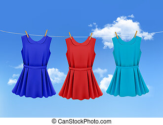 Set of colored dresses hanging on a clothesline on a sunny day. Vector illustration