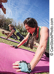 People Doing Push-Ups - Boot camp fitness instructor timing...