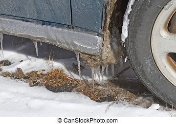 Thawing Car - A car with icicles hanging from it begins a...
