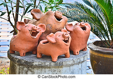 Laughing pig statue