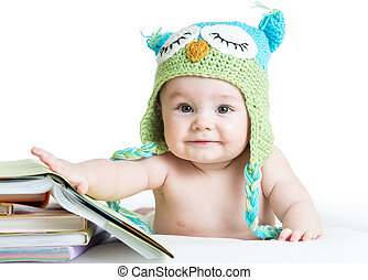 baby in funny knitted hat owl with books on white background...