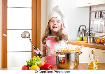 Chef girl preparing healthy food and showing thumb up