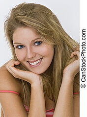 Woman With Friendly face - Studio shot of a beautiful blond...