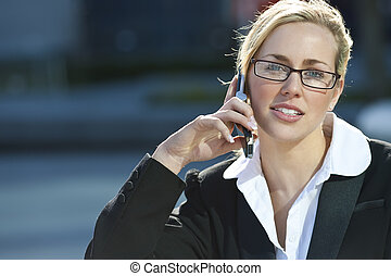 Female Executive Cell Phone Call - A beautiful young female...