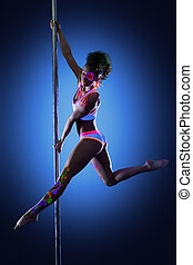 Sexy pole dancer posing with ultraviolet makeup, on blue...