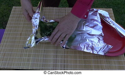 preparing fresh zucchini for cooking in foil