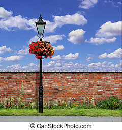 Brick Wall with Street Light - A Red Brick Wall with an Old...