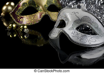 Masks - Carnival masks and christmas decoration on a black...