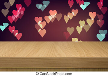 Holiday background with empty wooden table and heart bokeh...