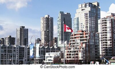 Canadian Flag waving w High Rise - Canadian Flag waving with...