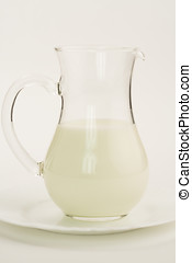 milk - Jug of skim milk on white background