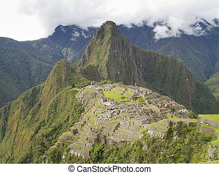 Machu Picchu in Cusco, Peru - Machu Picchu, the lost city of...