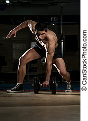Young Body Builder Lifting Heavy Dumbbell - Body Builder...