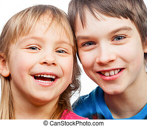 Sister and brother smiling