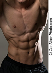Abdominal Muscles - Young Muscular Men Flexing Abdominal...