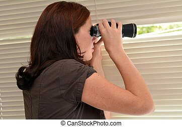 Spy Woman - Young woman (age 25-30 ) searching with...