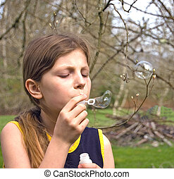 Nice Looking Girl Blowing Bubbles