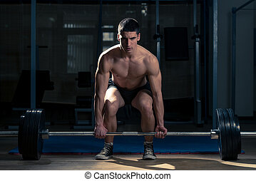 Dead lift - Muscular Man Lifting Deadlift In The Gym