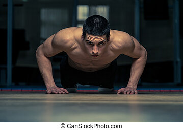 Push-Ups - Young Athlete Doing Push-Ups As Part Of Crossfit...