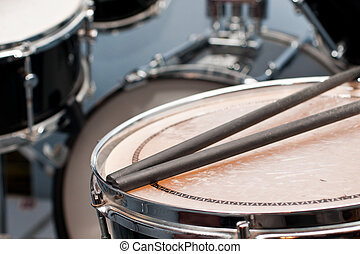 drum-sticks on Snare-Drums