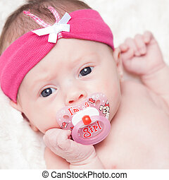 happy newborn baby girl just a week old photographed in the...