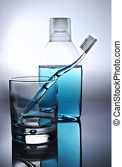 toothbrush, mouthwash and glass, backlit