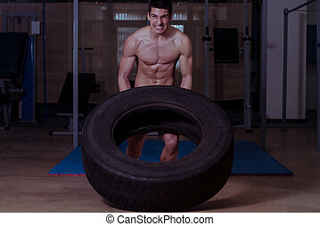 Tire Workout - Muscular Men With Truck Tire Doing Crossfit...