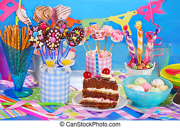 birthday party table with torte and sweets for kids -...