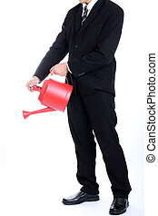 Businessman holding red watering pot for delopment something...
